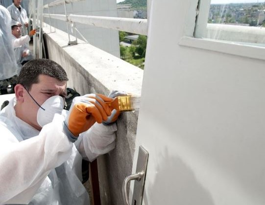 Painting the roof of a medical building